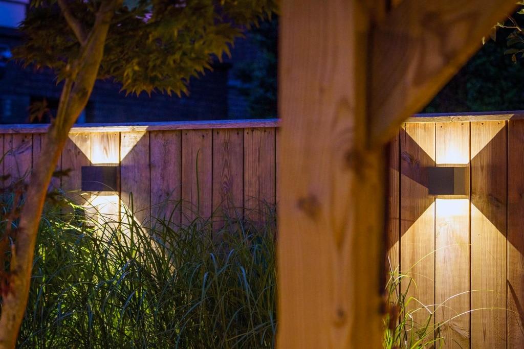 Solar tuinverlichting voor aan de schutting